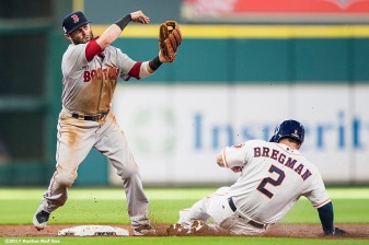 HOUSTON, TX - OCTOBER 5: Dustin Pedroia #15 of the Boston Red Sox turns a double play over Alex Bregman #2 of the Houston Astros during the third inning of game one of the American League Division Series on October 5, 2017 at Minute Maid Park in Houston, Texas. (Photo by Billie Weiss/Boston Red Sox/Getty Images) *** Local Caption *** Dustin Pedroia; Alex Bregman