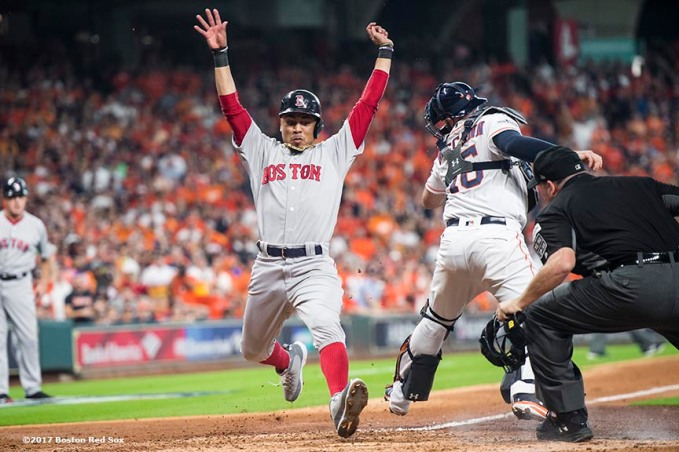 HOUSTON, TX - OCTOBER 5: Mookie Betts #50 of the Boston Red Sox scores as he evades the tag of Brian McCann #16 of the Houston Astros during the third inning of game one of the American League Division Series on October 5, 2017 at Minute Maid Park in Houston, Texas. (Photo by Billie Weiss/Boston Red Sox/Getty Images) *** Local Caption *** Mookie Betts; Brian McCann