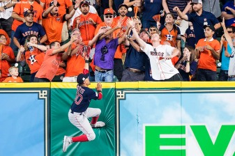 HOUSTON, TX - OCTOBER 6: Mookie Betts #50 of the Boston Red Sox leaps as he attempts to catch a solo home run hit by George Springer #4 of the Houston Astros during the third inning of game two of the American League Division Series on October 6, 2017 at Minute Maid Park in Houston, Texas. (Photo by Billie Weiss/Boston Red Sox/Getty Images) *** Local Caption *** Mookie Betts; George Springer