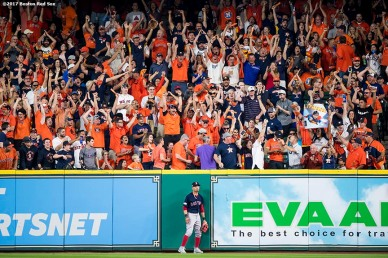 HOUSTON, TX - OCTOBER 6: Mookie Betts #50 of the Boston Red Sox reacts after attempting to catch a solo home run hit by George Springer #4 of the Houston Astros during the third inning of game two of the American League Division Series on October 6, 2017 at Minute Maid Park in Houston, Texas. (Photo by Billie Weiss/Boston Red Sox/Getty Images) *** Local Caption *** Mookie Betts; George Springer