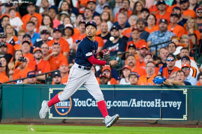 HOUSTON, TX - OCTOBER 6: Mookie Betts #50 of the Boston Red Sox drops the ball as he transfers to throw after making a catch during the sixth inning of game two of the American League Division Series against the Houston Astros on October 6, 2017 at Minute Maid Park in Houston, Texas. (Photo by Billie Weiss/Boston Red Sox/Getty Images) *** Local Caption *** Mookie Betts