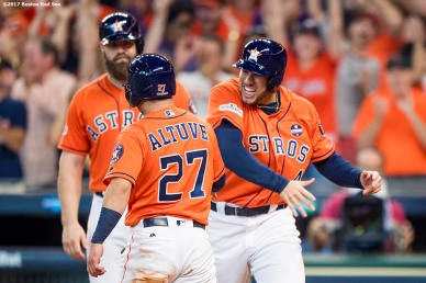 HOUSTON, TX - OCTOBER 6: George Springer #4 reacts as Jose Altuve #27 of the Houston Astros scores during the sixth inning of game two of the American League Division Series against the Boston Red Sox on October 6, 2017 at Minute Maid Park in Houston, Texas. (Photo by Billie Weiss/Boston Red Sox/Getty Images) *** Local Caption *** George Springer; Jose Altuve