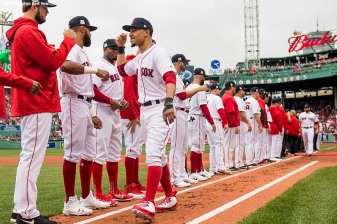 BOSTON, MA - OCTOBER 8: Mookie Betts #2 of the Boston Red Sox high fives teammates as he is introduced before game three of the American League Division Series against the Houston Astros on October 8, 2017 at Fenway Park in Boston, Massachusetts. (Photo by Billie Weiss/Boston Red Sox/Getty Images) *** Local Caption *** Mookie Betts