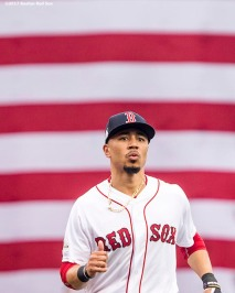 BOSTON, MA - OCTOBER 8: Mookie Betts #50 of the Boston Red Sox warms up before game three of the American League Division Series against the Houston Astros on October 8, 2017 at Fenway Park in Boston, Massachusetts. (Photo by Billie Weiss/Boston Red Sox/Getty Images) *** Local Caption *** Mookie Betts