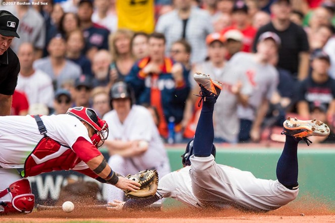 BOSTON, MA - OCTOBER 8: George Springer #4 of the Houston Astros slides as he scores and evades the tag of Sandy Leon #3 of the Boston Red Sox during the first inning of game three of the American League Division Series on October 8, 2017 at Fenway Park in Boston, Massachusetts. (Photo by Billie Weiss/Boston Red Sox/Getty Images) *** Local Caption *** George Springer; Sandy Leon