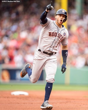 BOSTON, MA - OCTOBER 8: Carlos Correa #1of the Houston Astros reacts after hitting a two run home run during the first inning of game three of the American League Division Series against the Boston Red Sox on October 8, 2017 at Fenway Park in Boston, Massachusetts. (Photo by Billie Weiss/Boston Red Sox/Getty Images) *** Local Caption *** Carlos Correa