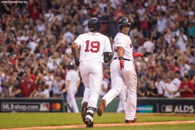 BOSTON, MA - OCTOBER 8: Jackie Bradley Jr. #19 of the Boston Red Sox follows Rafael Devers as they round the bases after Bradley Jr. hit a two run home run during the seventh inning of game three of the American League Division Series against the Houston Astros on October 8, 2017 at Fenway Park in Boston, Massachusetts. (Photo by Billie Weiss/Boston Red Sox/Getty Images) *** Local Caption *** Jackie Bradley Jr.; Rafael Devers