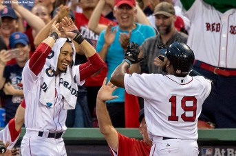 BOSTON, MA - OCTOBER 8: Jackie Bradley Jr. #19 of the Boston Red Sox high fives Mookie Betts #50 after hitting a two run home run during the seventh inning of game three of the American League Division Series against the Houston Astros on October 8, 2017 at Fenway Park in Boston, Massachusetts. (Photo by Billie Weiss/Boston Red Sox/Getty Images) *** Local Caption *** Jackie Bradley Jr.; Mookie Betts