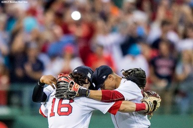 BOSTON, MA - OCTOBER 8: Mookie Betts #50, Jackie Bradley Jr. #19, and Andrew Benintendi #16 of the Boston Red Sox celebrate a victory in game three of the American League Division Series against the Houston Astros on October 8, 2017 at Fenway Park in Boston, Massachusetts. (Photo by Billie Weiss/Boston Red Sox/Getty Images) *** Local Caption *** Mookie Betts; Andrew Benintendi; Jackie Bradley Jr.