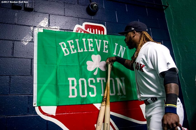 BOSTON, MA - OCTOBER 9: Hanley Ramirez #13 of the Boston Red Sox touches a 'Believe In Boston' flag before game four of the American League Division Series against the Houston Astros on October 9, 2017 at Fenway Park in Boston, Massachusetts. (Photo by Billie Weiss/Boston Red Sox/Getty Images) *** Local Caption *** Hanley Ramirez