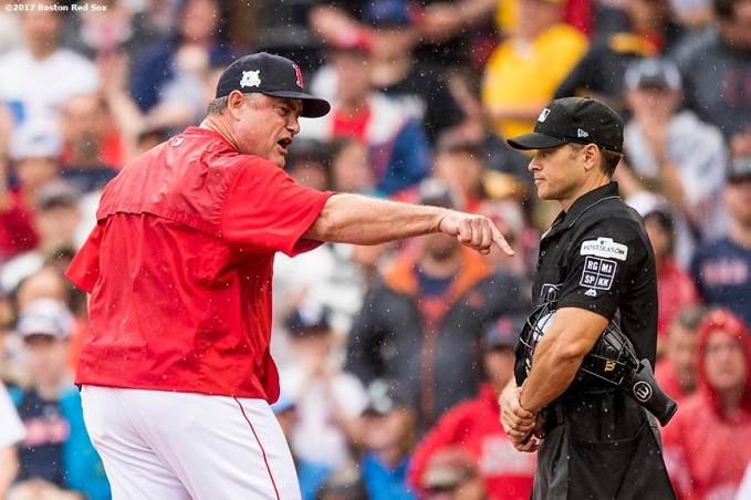 BOSTON, MA - OCTOBER 9: Manager John Farrell of the Boston Red Sox argues with home plate umpire Mark Wegner during the second inning of game four of the American League Division Series against the Houston Astros on October 9, 2017 at Fenway Park in Boston, Massachusetts. He was ejected from the game. (Photo by Billie Weiss/Boston Red Sox/Getty Images) *** Local Caption *** John Farrell; Mark Wegner