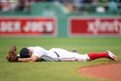 BOSTON, MA - OCTOBER 9: Xander Bogaerts #2 of the Boston Red Sox reacts after being unable to reach a ground ball during the inning of game four of the American League Division Series against the Houston Astros on October 9, 2017 at Fenway Park in Boston, Massachusetts. (Photo by Billie Weiss/Boston Red Sox/Getty Images) *** Local Caption *** Xander Bogaerts