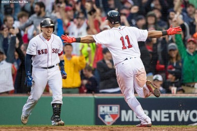 BOSTON, MA - OCTOBER 9: Rafael Devers #11 of the Boston Red Sox reacts with Christian Vazquez #7 after hitting an inside the park home run during the ninth inning of game four of the American League Division Series against the Houston Astros on October 9, 2017 at Fenway Park in Boston, Massachusetts. (Photo by Billie Weiss/Boston Red Sox/Getty Images) *** Local Caption *** Rafael Devers; Christian Vazquez