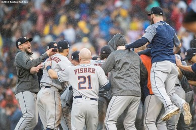 BOSTON, MA - OCTOBER 9: Members of the Houston Astros celebrate after recording the final out to clinch the series in game four of the American League Division Series against the Boston Red Sox on October 9, 2017 at Fenway Park in Boston, Massachusetts. (Photo by Billie Weiss/Boston Red Sox/Getty Images) *** Local Caption ***