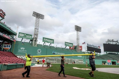 October 24, 2017, Boston, MA: Workers carry the crossbar as the goal post is installed before the 2017 Fenway Gridiron Series presented by Your Call Football at Fenway Park in Boston, Massachusetts Tuesday, October 24, 2017. (Photo by Billie Weiss/Boston Red Sox)