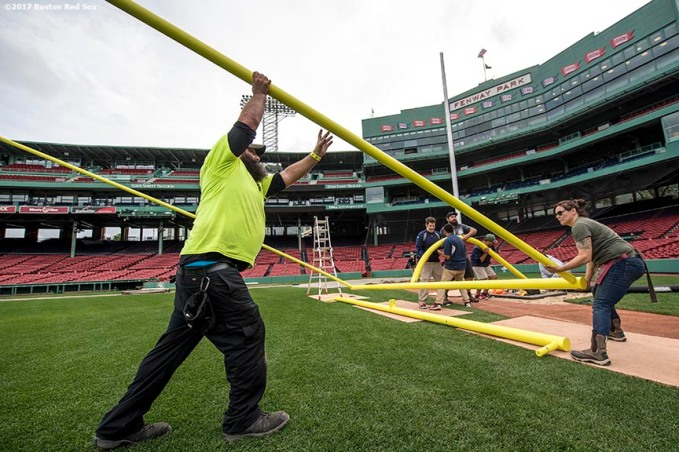 October 24, 2017, Boston, MA: Workers hoist up the goal post as it is installed before the 2017 Fenway Gridiron Series presented by Your Call Football at Fenway Park in Boston, Massachusetts Tuesday, October 24, 2017. (Photo by Billie Weiss/Boston Red Sox)