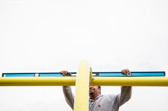 October 24, 2017, Boston, MA: A worker checks the level as the goal post is installed before the 2017 Fenway Gridiron Series presented by Your Call Football at Fenway Park in Boston, Massachusetts Tuesday, October 24, 2017. (Photo by Billie Weiss/Boston Red Sox)