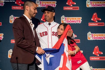BOSTON, MA - NOVEMBER 6: Alex Cora hugs his son Jeriel Cora and daughter Camila Cora with a Puerto Rico flag after a press conference introducing Cora as the next manager of the Boston Red Sox on November 6, 2017 at Fenway Park in Boston, Massachusetts. (Photo by Billie Weiss/Boston Red Sox/Getty Images) *** Local Caption *** Alex Cora; Jeriel Cora, Camila Cora