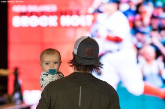 November 9, 2017, Boston, MA: Boston Red Sox infielder Brock Holt enters the building with his son Griff during a visit to the New Balance Headquarters in Boston, Massachusetts Wednesday, November 9, 2017. (Photo by Billie Weiss/Boston Red Sox)