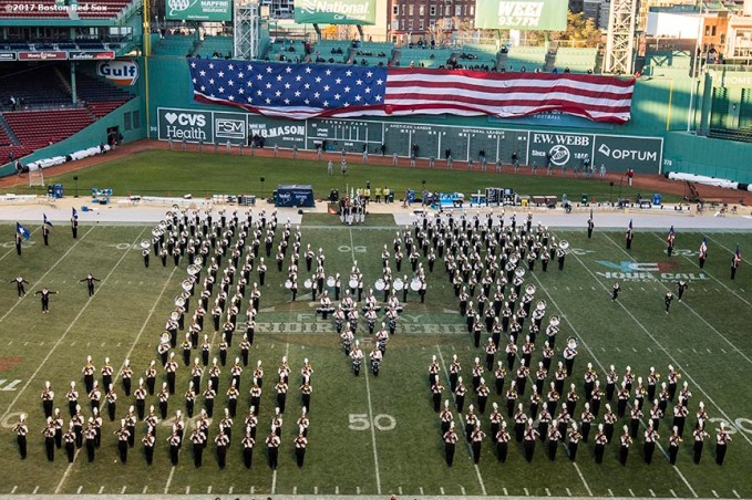 November 11, 2017, Boston, MA: The American flag is dropped over the Green Monster as the University of Massachusetts Marching Band forms an 'M' as they perform before a game against the University of Maine during the Fenway Gridiron Series presented by Your Call Football at Fenway Park in Boston, Massachusetts Saturday, November 11, 2017. (Photo by Billie Weiss/Boston Red Sox)