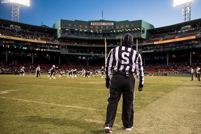 November 11, 2017, Boston, MA: A referee looks on during a game between University of Massachusetts and University of Maine during the Fenway Gridiron Series presented by Your Call Football at Fenway Park in Boston, Massachusetts Saturday, November 11, 2017. (Photo by Billie Weiss/Boston Red Sox)