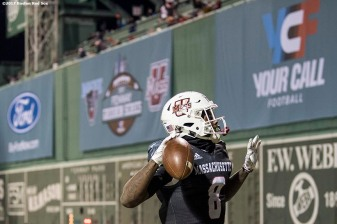 November 11, 2017, Boston, MA: A member of the University of Massachusetts reacts after scoring a touchdown during a game against the University of Maine during the Fenway Gridiron Series presented by Your Call Football at Fenway Park in Boston, Massachusetts Saturday, November 11, 2017. (Photo by Billie Weiss/Boston Red Sox)