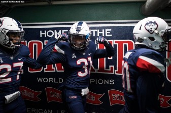 November 18, 2017, Boston, MA: Members of the University of Connecticut walk through the tunnel before a game against Boston College during the Fenway Gridiron Series presented by Your Call Football at Fenway Park in Boston, Massachusetts Saturday, November 18, 2017. (Photo by Billie Weiss/Boston Red Sox)