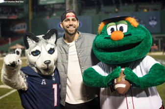 November 18, 2017, Boston, MA: Boston Red Sox pitcher Matt Barnes poses for a photograph with mascots before a game between the University of Connecticut and Boston College during the Fenway Gridiron Series presented by Your Call Football at Fenway Park in Boston, Massachusetts Saturday, November 18, 2017. (Photo by Billie Weiss/Boston Red Sox)