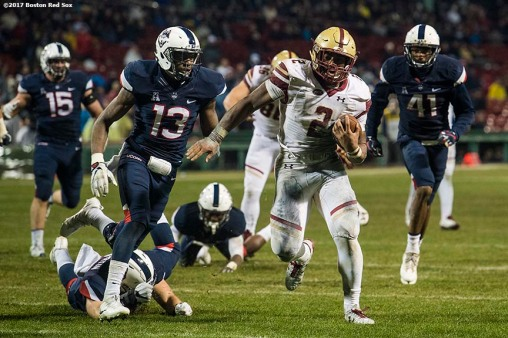 November 18, 2017, Boston, MA: Game action during a game between University of Connecticut and Boston College during the Fenway Gridiron Series presented by Your Call Football at Fenway Park in Boston, Massachusetts Saturday, November 18, 2017. (Photo by Billie Weiss/Boston Red Sox)