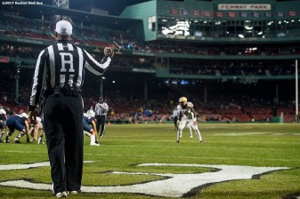 November 18, 2017, Boston, MA: A referee looks on during a game between University of Connecticut and Boston College during the Fenway Gridiron Series presented by Your Call Football at Fenway Park in Boston, Massachusetts Saturday, November 18, 2017. (Photo by Billie Weiss/Boston Red Sox)