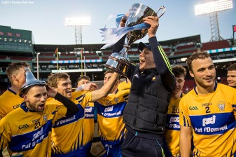 November 19, 2017, Boston, MA: Members of Clare react with the trophy after defeating Galway in the final match during the AIG Fenway Hurling Classic and Irish Festival at Fenway Park in Boston, Massachusetts Sunday, November 19, 2017. (Photo by Billie Weiss/Boston Red Sox)
