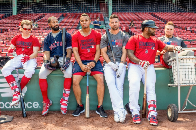 """Brock Holt #12, Chris Young #30, Xander Bogaerts #2, Deven Marrero #17, Pablo Sandoval #48, and Christian Vazquez #7 of the Boston Red Sox lean against the wall during a simulated agme before a game against the Los Angeles Angels of Anaheim on June 24, 2017 at Fenway Park in Boston, Massachusetts."""