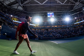 """Venus Williams walks onto the court before match against Oceane Dodin during the 2017 US Open Tennis Championships at the Billie Jean King National Tennis Center in New York, New York Wednesday, August 30, 2017."""
