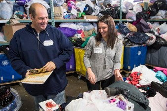 December 13, 2017, Boston, MA: Mark Cacciatore and Kathleen Harrington of the Boston Red Sox volunteer sorting clothes at Cradles To Crayons during The Gift Of Sox in Brighton, Massachusetts Wednesday, December 13, 2017. (Photo by Billie Weiss/Boston Red Sox)