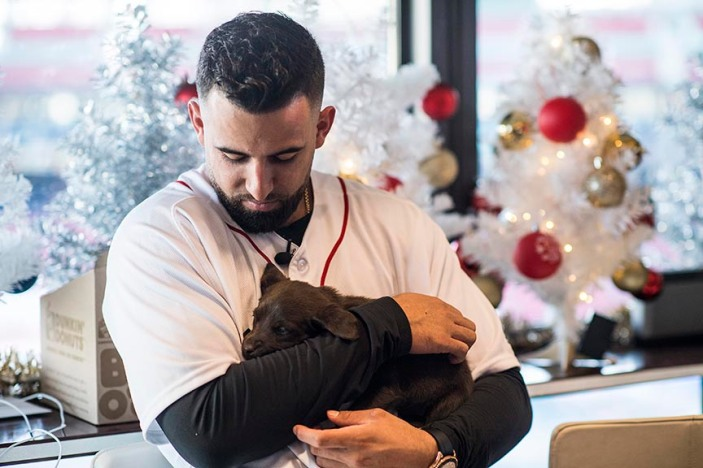 December 13, 2017, Roxbury, MA: Boston Red Sox infielder Deven Marrero holds a puppy from the Great Dog Rescue of New England during The Gift Of Sox at Fenway Park in Boston, Massachusetts Wednesday, December 13, 2017. (Photo by Billie Weiss/Boston Red Sox)