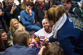 December 13, 2017, Roxbury, MA: Boston Red Sox pitcher Matt Barnes poses for photographs as he holds a puppy from the Great Dog Rescue of New England during a visit to Suffolk University duringThe Gift Of Sox in Boston, Massachusetts Wednesday, December 13, 2017. (Photo by Billie Weiss/Boston Red Sox)