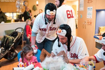 December 14, 2017, Boston, MA: Boston Red Sox pitchers Austin Maddox and Matt Barnes greet a patient during a visit to The Jimmy Fund at Dana-Farber Cancer Institute as part of the 2017 Holiday Caravan in Boston, Massachusetts Thursday, December 14, 2017. (Photo by Billie Weiss/Boston Red Sox)