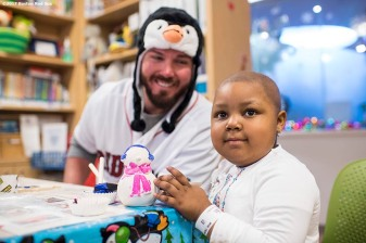 December 14, 2017, Boston, MA: Boston Red Sox pitcher Austin Maddox greets a patient during a visit to The Jimmy Fund at Dana-Farber Cancer Institute as part of the 2017 Holiday Caravan in Boston, Massachusetts Thursday, December 14, 2017. (Photo by Billie Weiss/Boston Red Sox)