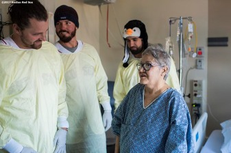 December 14, 2017, Boston, MA: Boston Red Sox pitchers Heath Hembree and Austin Maddox and infielder Deven Marrero greet a patient during a visit to Beth-Israel Deaconess Medical Center as part of the 2017 Holiday Caravan in Boston, Massachusetts Thursday, December 14, 2017. (Photo by Billie Weiss/Boston Red Sox)