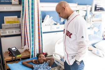 December 15, 2017, Boston, MA: Boston Red Sox manager Alex Cora greets a patient during a visit to Shriners Hospital For Children as part of the 2017 Red Sox Holiday Caravan in Boston, Massachusetts Friday, December 15, 2017. (Photo by Billie Weiss/Boston Red Sox)