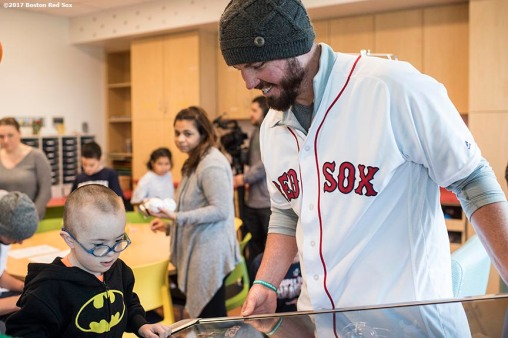 December 15, 2017, Boston, MA: Boston Red Sox pitcher Austin Maddox greets a patient during a visit to Massachusetts General Hospital as part of the 2017 Red Sox Holiday Caravan in Boston, Massachusetts Friday, December 15, 2017. (Photo by Billie Weiss/Boston Red Sox)