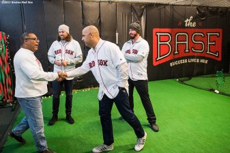 December 15, 2017, Roxbury, MA: Boston Red Sox manager Alex Cora shakes hands with Robert Lewis Jr. of The BASE alongside pitchers Heath Hembree and Austin Maddox during a visit to The BASE as part of the 2017 Red Sox Holiday Caravan in Roxbury, Massachusetts Friday, December 15, 2017. (Photo by Billie Weiss/Boston Red Sox)
