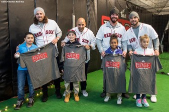 December 15, 2017, Roxbury, MA: Boston Red Sox pitcher Heath Hembree, manager Alex Cora, and pitchers Austin Maddox and Robby Scott are presented with t-shirts during a visit to The BASE as part of the 2017 Red Sox Holiday Caravan in Roxbury, Massachusetts Friday, December 15, 2017. (Photo by Billie Weiss/Boston Red Sox)