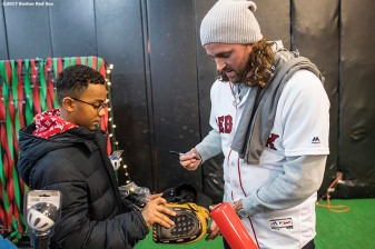 December 15, 2017, Roxbury, MA: Boston Red Sox pitcher Heath Hembree signs autographs with a Franklin Sports giveaway glove during a visit to The BASE as part of the 2017 Red Sox Holiday Caravan in Roxbury, Massachusetts Friday, December 15, 2017. (Photo by Billie Weiss/Boston Red Sox)