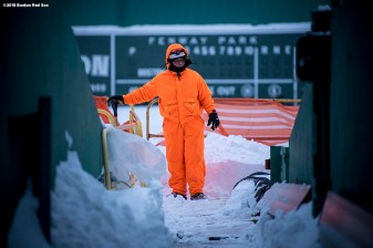 January 5, 2018, Boston, MA: A worker surveys the scene as he shovels snow after the Bomb Cyclone winter storm Grayson at Fenway Park in Boston, Massachusetts Friday, January 5, 2018. (Photo by Billie Weiss/Boston Red Sox)