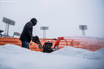 January 5, 2018, Boston, MA: A worker clears a path on the field with a snow blower after the Bomb Cyclone winter storm Grayson at Fenway Park in Boston, Massachusetts Friday, January 5, 2018. (Photo by Billie Weiss/Boston Red Sox)