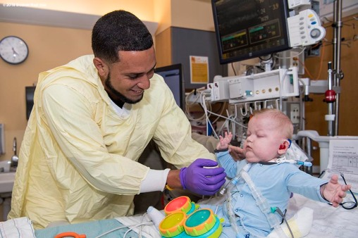 BOSTON, MA - JANUARY 16: Boston Red Sox rookie Williams Jerez visits Harrison at Boston Children's Hospital on January 16, 2018 in Boston, Massachusetts. (Photo by Billie Weiss/Getty Images for Boston Children's Hospital)