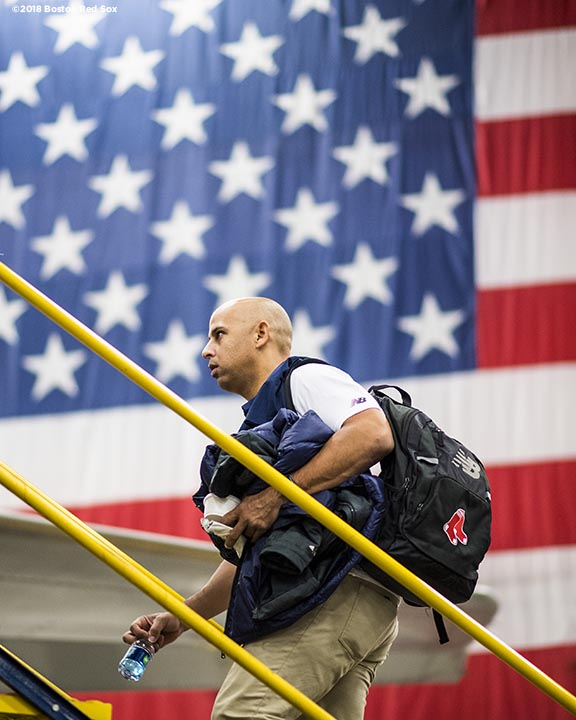 BOSTON, MA - JANUARY 30: Manager Alex Cora of the Boston Red Sox boards the plane inside the hangar at Boston Logan Airport during a Boston Red Sox hurricane relief trip from Boston, Massachusetts to Caguas, Puerto Rico on January 30, 2018 . (Photo by Billie Weiss/Boston Red Sox/Getty Images) *** Local Caption *** Alex Cora
