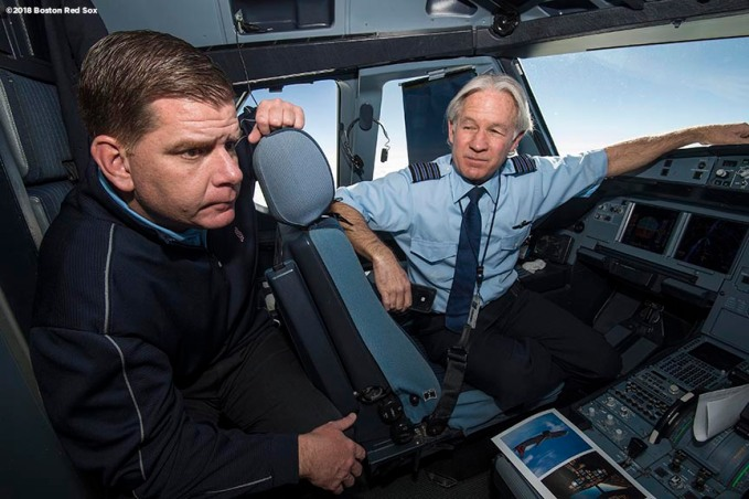 BOSTON, MA - JANUARY 30: Boston Mayor Marty Walsh talks with a pilot in the cockpit en route during a Boston Red Sox hurricane relief trip from Boston, Massachusetts to Caguas, Puerto Rico on January 30, 2018 . (Photo by Billie Weiss/Boston Red Sox/Getty Images) *** Local Caption *** Marty Walsh