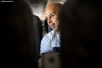 BOSTON, MA - JANUARY 30: Manager Alex Cora of the Boston Red Sox reacts on the plane en route during a Boston Red Sox hurricane relief trip from Boston, Massachusetts to Caguas, Puerto Rico on January 30, 2018 . (Photo by Billie Weiss/Boston Red Sox/Getty Images) *** Local Caption *** Alex Cora